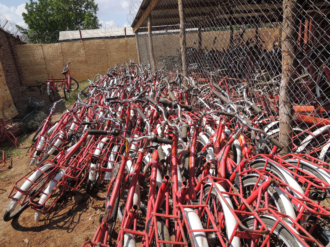 Royal Mail bikes awaiting refurbishment in Malawi.